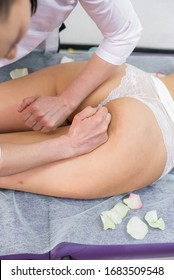 Girl massage therapist does anti-cellulite massage to a girl on a massage table in the spa salon . Spa treatments. Health and beauty