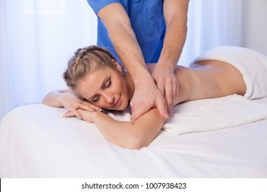 girl masseur doing massage back spa health
