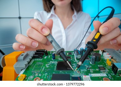 Girl with measuring devices in the electronics laboratory