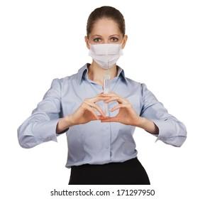 Girl in a medical mask holding syringe