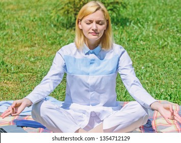 Girl meditate on rug green grass meadow nature background. Find minute to relax. Woman relaxing practicing meditation. Every day meditation. Reasons you should meditate every day. Clear your mind.