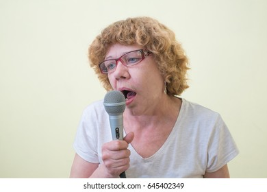 girl with microphone sings