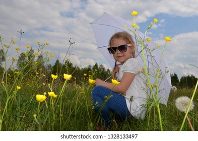 Girl in the middle of yellow flawers