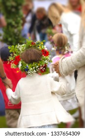 Girl with midsummer wreath.