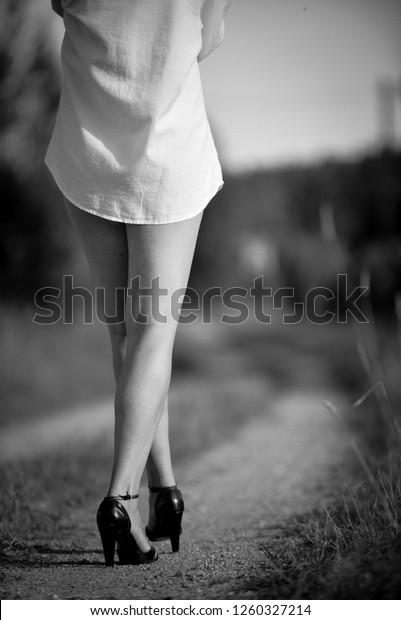 girl-mini-shorts-walking-along-600w-1260