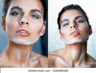 Girl model with creative makeup, paint strokes on the face. Creative person.Lips ajar, head slightly thrown back
