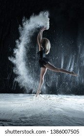girl model on a black background in flour
