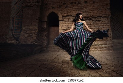 Girl, model, woman in a beautiful dress in the courtyard of the mosque. Beauty, style, fashion, national.