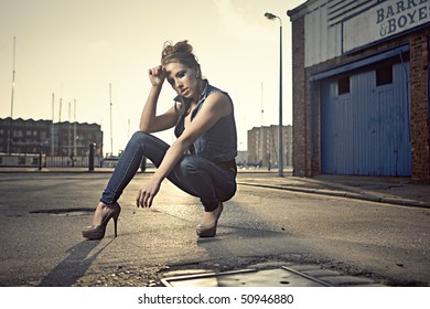 girl modeling clothes at an urban street location