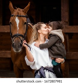 girl with mom near the horse