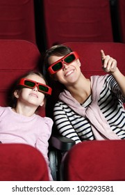 A girl with mother are watching 3D movie