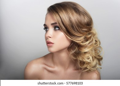 girl with natural make-up a hair-do is beautiful face of lip of eye hair curls blonde portrait spring a skin is good clean on a white background youth looks aside health