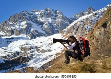 Girl nature photographer. Gran Paradiso National Park, Italian Alps.