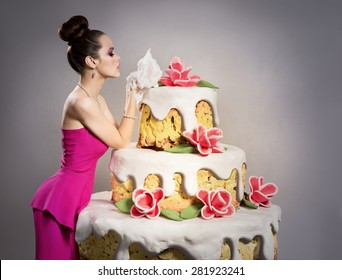 The Girl Near A Huge Birthday Cake