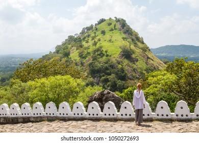 The girl near the mountain, Dambulla Cave Temple (Golden Temple of Dambulla), Sri Lanka