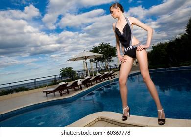 a girl near the swimming pool