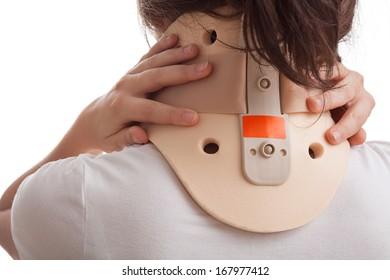 Girl with neck ache has a cervical collar