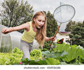 Girl with a net trying to catch butterflies.