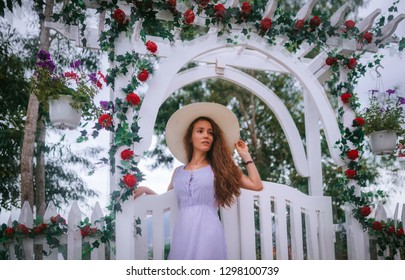 girl next to the arch with flowers