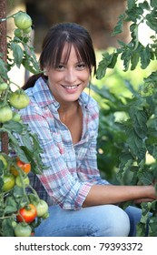 Girl next to tomatoes