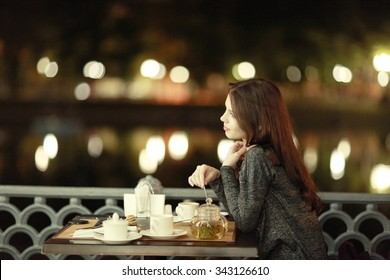 girl, night, dinner at an outdoor cafe