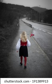 Girl in the Norwegian costume on her way to celebrate the day of the Constitution