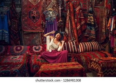 Girl in old carpet shop in Cappadocia, Goreme, Turkey.