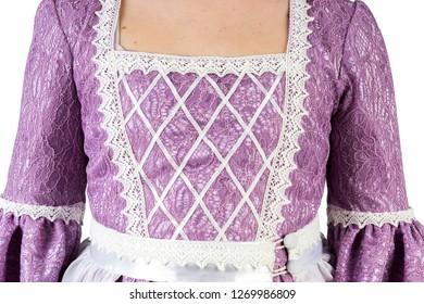 Girl in an old dress, on a white background.Stands back.The hand with the sleeve. Decolletage. Close up.