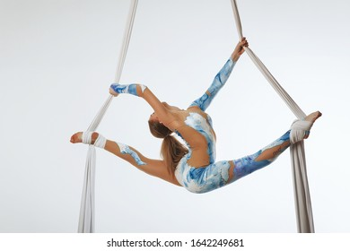 girl on the air silk gymnastics silhouette isolated on the white background