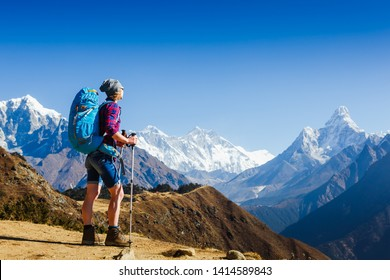 Girl on the background of Himalayas mountain peaks