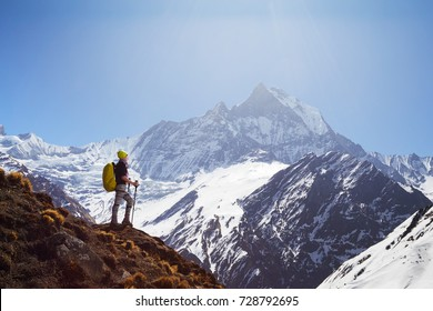 Girl on the background of mountain peaks