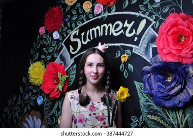 the girl on the background paper flowers