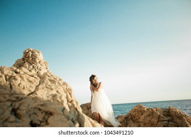 Girl on the background of the sea. Italy.