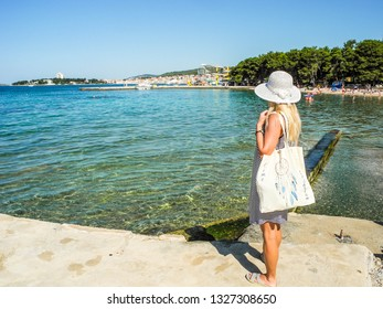 Girl on the background of Vodice beach, Croatia.