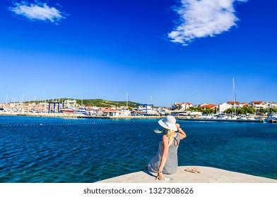 Girl on the background of Vodice cityscape, Croatia.