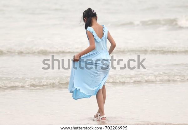 Girl on beach.