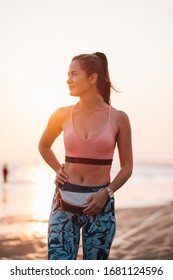 girl on the beach during sunset after jogging in sportswear