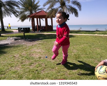 Girl on the beach of the industrial city of Jubail in the Kingdom of Saudi Arabia summer 2018