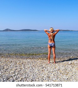 The girl on the beautiful beach of Vodice.