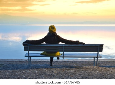 Girl on the bench. Lake of Zug, Switzerland