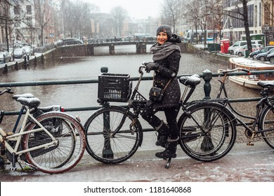Girl on a bicycle on the bridge. Amsterdam, Netherlands