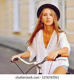 Girl on a bicycle - close up portrait