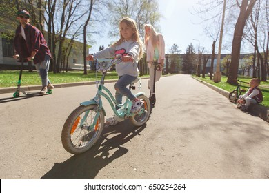 Girl on bicycle in park