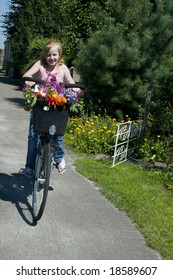Girl on a bike with flowers in the summer