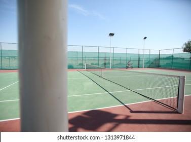 Girl on bike at Tennis Court