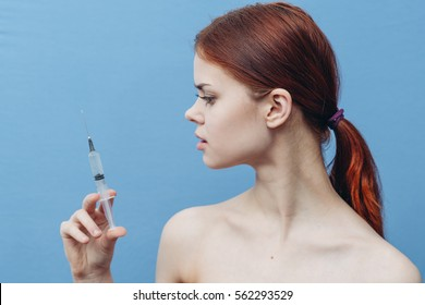 girl on a blue background with a syringe in his hand