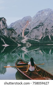girl on a boat on the lake braies