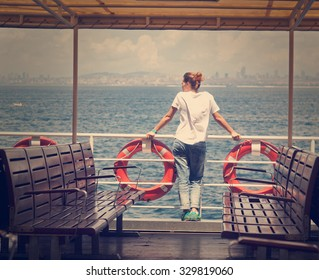 girl on the boat, watching the sea