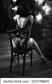 Girl on a chair in erotic lingerie