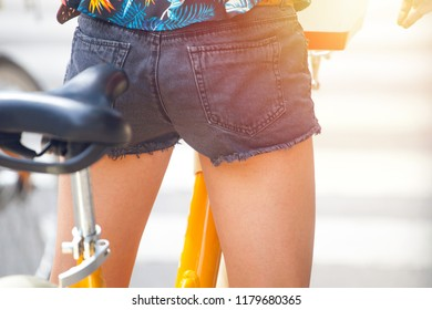 girl on a city bicycle at a street crossing, Milan, italy.